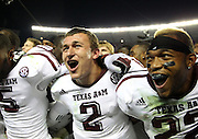 TUSCALOOSA, AL - NOVEMBER 10:  Quarterback Johnny Manziel #2 (center), defensive back Dustin Harris #22 (right) and wide receiver Kenric McNeal #5 of the Texas A&M Aggies celebrate after the game against the Alabama Crimson Tide Texas A&M Aggies at Bryant-Denny Stadium on November 10, 2012 in Tuscaloosa, Alabama.  The Aggies beat the Crimson Tide 29-24.  (Photo by Mike Zarrilli/Getty Images)