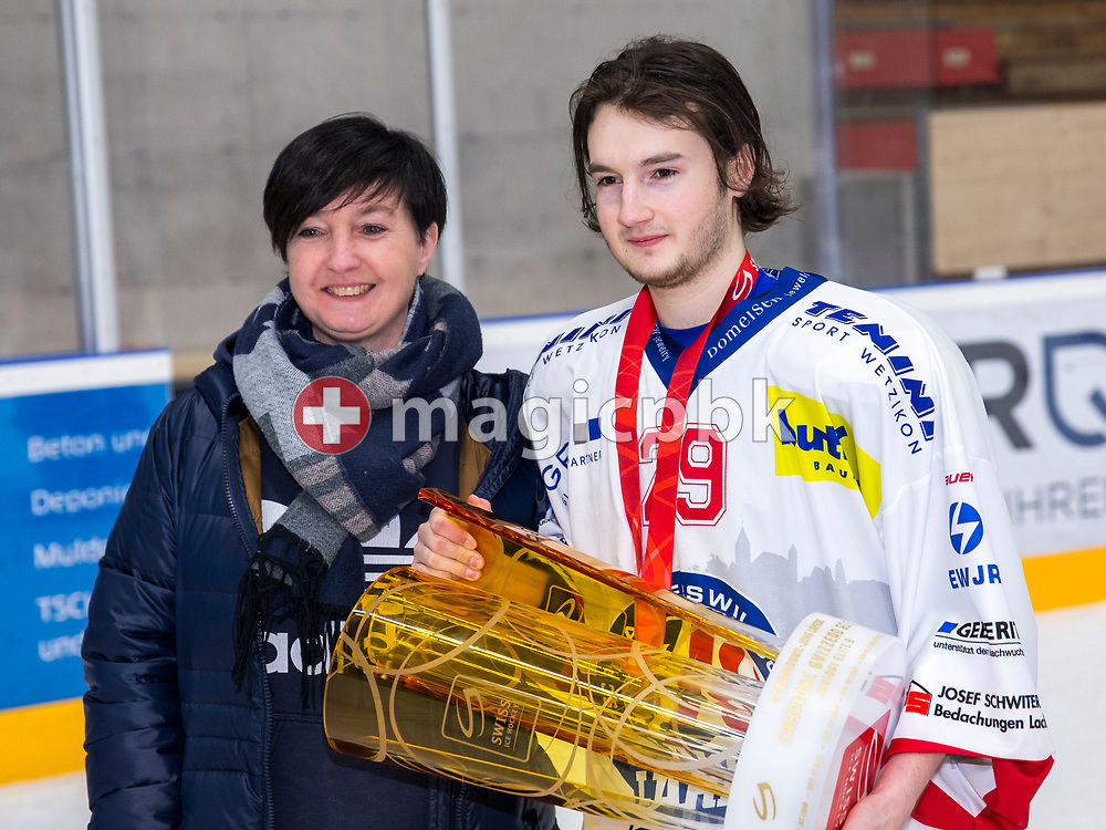 Rapperswil-Jona Lakers defenseman Fabricio Giger poses for a photo with the Swiss Champion trophy after winning ice hockey game 4 of the Elite B Playoff Final between EHC Chur Capricorns and Rapperswil-Jona Lakers in Chur, Switzerland, Friday, March 16, 2018. (Photo by Patrick B. Kraemer / MAGICPBK)