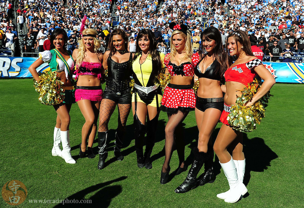 November 1, 2009; San Diego, CA, USA; San Diego Charger Girls (l-r) Tiffany, Heather, Belinda, Ashlie, Nicole L., Casie, and Carly N. pose for a photo during the first quarter against the Oakland Raiders at Qualcomm Stadium. The Chargers defeated the Raiders 24-16. Mandatory Credit: Kyle Terada-Terada Photo