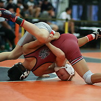Linus Blom of Saratoga ties up Erik Puga Lopez of Fremont in the 2018 SCVAL Wrestling Championships (106 lbs finals) (Photo by Bill Gerth)