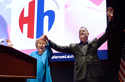 """Actor and Campaign Chair Tom Hanks (R) and Elizabeth Dole Foundation Founder and President Elizabeth Dole cheer during the launch of """"Hidden Heroes"""" campaign at the Capitol September 27, 2016 in Washington, DC. The Hidden Heroes campaign has been created to generate stronger support for America's 5.5 million military and veteran caregivers. Photo by Olivier Douliery/Abaca"""