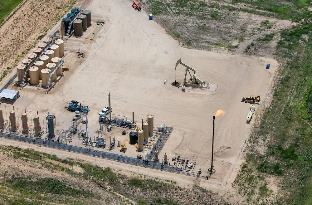 Fracking industry site that next to the Lyssy's farm in the Eagle Ford Shale. Some days the fumes drift over their land forcing them to remain indoors.