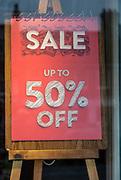 Sale 50% off shop display, High street shopping Marlborough, Wiltshire, England, UK - January 2021