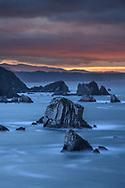 Dusk with sunset on a rocky coast with rock towers in the sea, Asturias, Spain<br /> <br /> Abenddämmerung mit Abendrot an einer Felsküste mit Felstürmen im Meer, Asturien, Spanien