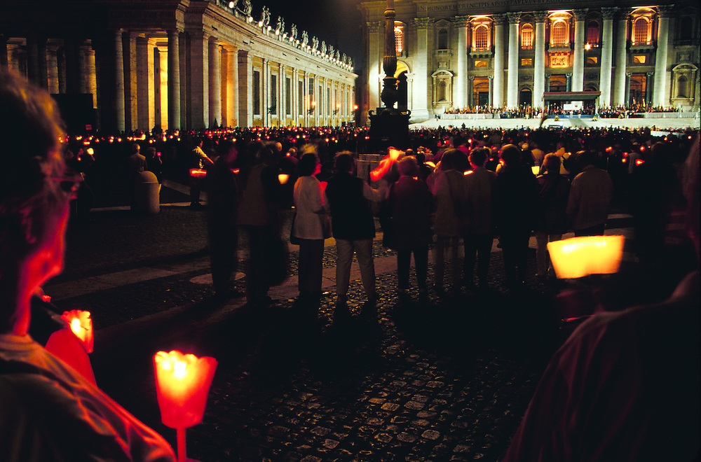 Europe, Italy, Rome, worshippers with candles near Vatican
