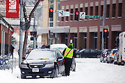 Even the frigid temperatures are not enough to keep the parking meter police from dropping a ticket or two. Missoula Photographer, Picture of Missoula