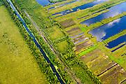Nederland, Noord-Brabant, Gemeente Deurne, 26-06-2014; Deurnsche Peel met Kanaal van Deurne, ten noorden van Helenaveen. Onderdeel van Deurnese Peel-Mariapeel. Ontstaan door het ontginnen van het oorspronkelijke hoogveengebied.<br /> Remainders of (reclaimed) peatland and bog, known as the Peel.<br /> luchtfoto (toeslag op standaard tarieven);<br /> aerial photo (additional fee required);<br /> copyright foto/photo Siebe Swart.