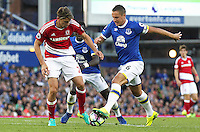 Middlesbrough's Gaston Ramirez vies for possession with Everton's Phil Jagielka<br /> <br /> Photographer Rich Linley/CameraSport<br /> <br /> The Premier League - Everton v Middlesbrough - Saturday 17th September 2016 - Goodison Park - Liverpool<br /> <br /> World Copyright © 2016 CameraSport. All rights reserved. 43 Linden Ave. Countesthorpe. Leicester. England. LE8 5PG - Tel: +44 (0) 116 277 4147 - admin@camerasport.com - www.camerasport.com