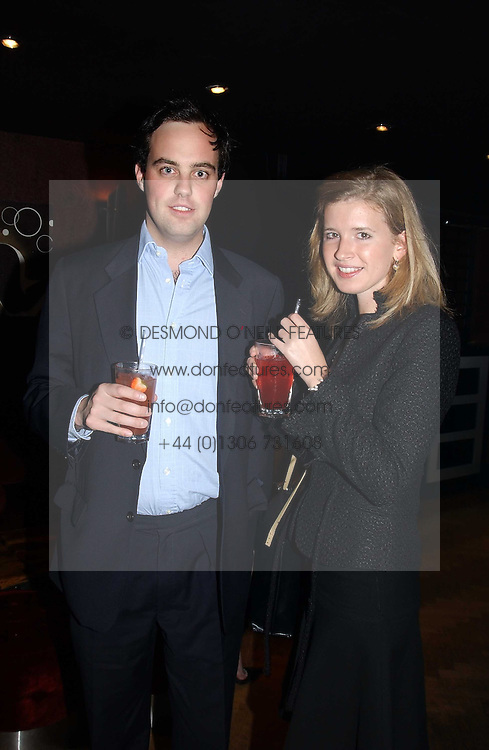 LORD BUCKHURST and ALICE HAWKINS at a party to celebrate a new collection of sexy underware by Janet Reger called 'Naughty Janet' held at 5 Cavendish Square, London on 19th October 2004.<br />