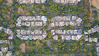Top Aerial view of a neighbourhood surrounded by parks in Rajendra nagar during daylight in New Delhi, India.