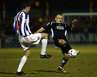 Photo: Chris Ratcliffe.<br /> Colchester United v Swansea City. LDV Vans Trophy. 14/03/2006.<br /> Pat Baldwin (L) of Colchester tackles Andy Robinson of Swansea