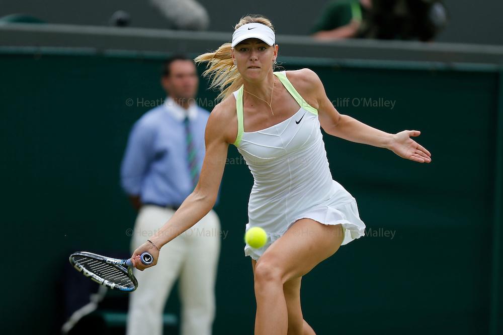 Mcc0038137 . Daily Telegraph..Wimbledon Day 3..Maria Sharapova vs Tsvetana Pironkova in the reminder of the match from yesterday on No 1 Court at Wimbledon 2012...28 June 2012