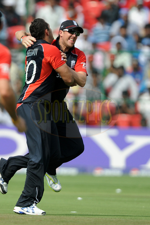 Tim Bresnan of England celebrates the wicket of Virender Sehwag of India during the ICC Cricket World Cup match between India and England held at the M Chinnaswamy Stadium in Bengaluru, Bangalore, Karnataka, India on the 27th February 2011..Photo by Pal Pillai/BCCI/SPORTZPICS