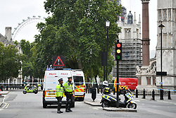 © Licensed to London News Pictures. 14/08/2018. London, UK. Police are seen outside Parliament after a car crashed into security barriers in Parliament Square. Photo credit: Ben Cawthra/LNP