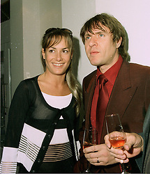 MISS TARA PALMER-TOMKINSON and singer SIMON LE BON  at a party in London on 13th May 1997.LYG 75