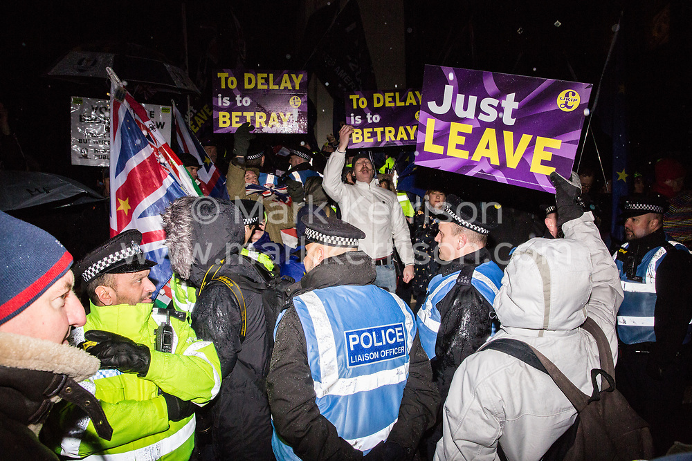 London, UK. 29th January, 2019. Rival pro- and anti-Brexit protesters gather outside Parliament in the rain as MPs vote on amendments to the Prime Minister's final Brexit withdrawal agreement which could determine the content of the next stage of negotiations with the European Union.