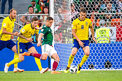 June 27, 2018 - Ekaterinburg, Russia - 180627 Javier Hernandez  of Mexico  against Andreas Granqvist, Victor Nilsson LindelÅ¡f and Albin Ekdal of Sweden during the FIFA World Cup group stage match between Mexico and Sweden on June 27, 2018 in Ekaterinburg..Photo: Petter Arvidson / BILDBYRN / kod PA / 87737 (Credit Image: © Petter Arvidson/Bildbyran via ZUMA Press)