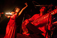 Brooklyn, New York | 2008<br /> Musician and composer Neel Murgai plays sitar for several groups, including Mission on Mars, an eclectic jazz-fusion combo, shown here at a club in Williamsburg, with Kaeshi Chai of Bellyqueen Dance Theater.