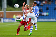 Colchester United defender Lewis Kinsella (3) and Stevenage striker Alex Samuel (15) battles for possession during the EFL Sky Bet League 2 match between Colchester United and Stevenage at the Weston Homes Community Stadium, Colchester, England on 12 August 2017. Photo by Phil Chaplin.