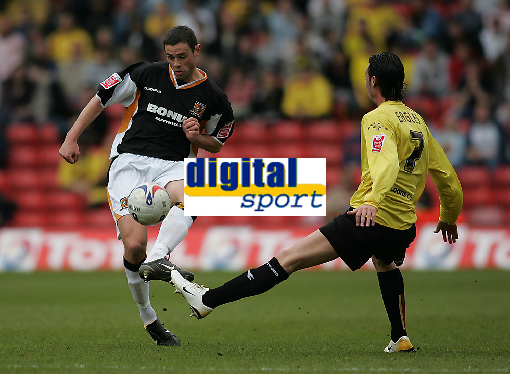 Photo: Lee Earle.<br /> Watford v Hull. Coca Cola Championship. 30/04/2006. Hull's Damien Delaney (L) clears from Chris Eagles.