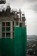MDC construction workers during the day on top on Garden Towers under construction in Makati, Metro Manila, Philippines.  (photo by Andrew Aitchison / In pictures via Getty Images)