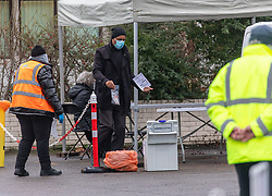 © Licensed to London News Pictures. 03/02/2021. London, UK. 1000s of residents are being tested for the South African variant at an enhanced testing facility in Pollards Hill, Mitcham, South London today after residents with the the mutation were discovered in the area.  A Covid testing centre in a high risk area of Mitcham, South London has been set up this morning as the South African variant spreads across the Capital. This week two people tested positive in Woking, Surrey for the new variant by community transmission with no links to South Africa as tens of thousands of people in the South East will be offered urgent Covid-19 tests. Yesterday, Health Minister Matt Hancock urged residents to stay at home and take extra special precautions. Photo credit: Alex Lentati/LNP