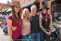 Olivia (L>R), Sharon, Scott and Alexa Jacobs outside the Scott Jacobs Gallery where they all work on Main Street in Deadwood during the annual Sturgis Black Hills Motorcycle Rally. Deadwood, SD, USA. Monday August 7, 2017.  Photography ©2017 Michael Lichter.