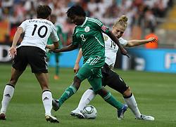 30.06.2011, Commerzbank Arena, Frankfurt, GER, FIFA Women Worldcup 2011, Gruppe A, Deutschland (GER) vs. Nigeria (NGA), im Bild .Kim Kulig (GER) gegen Ebere Orji (NGA) .// during the FIFA Women Worldcup 2011, Pool A, Germany vs Nigeria on 2011/06/30, Commerzbank Arena, Frankfurt, Germany.  EXPA Pictures © 2011, PhotoCredit: EXPA/ nph/  Karina Hessland       ****** out of GER / CRO  / BEL ******