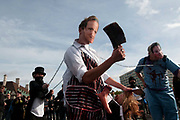 October 9th 2011. Blockade of Westminster Bridge organised by UK Uncut before the NHS bill goes before Parliament on October 12th. A man wearing a David Cameron mask wields an axe and holds pretend body parts.