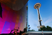 Seattle Space Needle and the EMP building at the Seattle Center with the Monorail in the foreground.