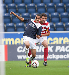 Falkirk's Phil Roberts and Hamilton's Martin Canning<br /> half time : Falkirk 0 v  0 Hamilton, Scottish Championship 31/8/2013.<br /> ©Michael Schofield.