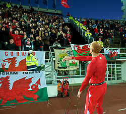 HELSINKI, FINLAND - Saturday, October 10, 2009: Wales' James Collins throws his shirt to the supporters after the 2010 FIFA World Cup Qualifying Group 4 match against Finland at the Olympic Stadium. (Pic by David Rawcliffe/Propaganda)