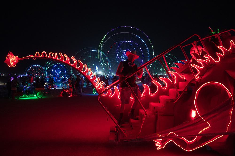 I was making an image here and this man just appeared right at the moment the timer on the camera activated. Happy accident. I like it. My Burning Man 2018 Photos:<br /> https://Duncan.co/Burning-Man-2018<br /> <br /> My Burning Man 2017 Photos:<br /> https://Duncan.co/Burning-Man-2017<br /> <br /> My Burning Man 2016 Photos:<br /> https://Duncan.co/Burning-Man-2016<br /> <br /> My Burning Man 2015 Photos:<br /> https://Duncan.co/Burning-Man-2015<br /> <br /> My Burning Man 2014 Photos:<br /> https://Duncan.co/Burning-Man-2014<br /> <br /> My Burning Man 2013 Photos:<br /> https://Duncan.co/Burning-Man-2013<br /> <br /> My Burning Man 2012 Photos:<br /> https://Duncan.co/Burning-Man-2012
