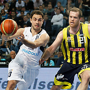 Efes Pilsen's Ender ARSLAN (L) and Fenerbahce's Oguz SAVAS (R) during their Turkish Basketball Legague Play-Off semi final second match Efes Pilsen between Fenerbahce at the Sinan Erdem Arena in Istanbul Turkey on Friday 27 May 2011. Photo by TURKPIX
