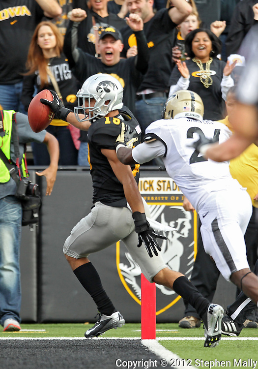 November 10 2012: Iowa Hawkeyes cornerback Micah Hyde (18) scores a touchdown in front of Purdue Boilermakers running back Akeem Shavers (24) on a 9 yard run after a fumble during the NCAA football game between the Purdue Boilermakers and the Iowa Hawkeyes at Kinnick Stadium in Iowa City, Iowa on Saturday, November 10, 2012. Purdue defeated Iowa 27-24.