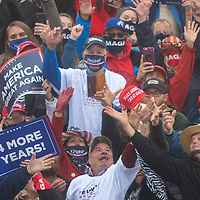 LITITZ, PA - OCTOBER 26:  Supporters strain to catch a Make America Great Again hat thrown by President Donald Trump during a rally on October 26, 2020 in Lititz, Pennsylvania.  With 8 days to go before the election, Trump is today holding 3 rallies across Pennsylvania, a crucial battleground state.  In 2016, Trump won Pennsylvania by only 44,000 votes out of more than 6 million cast, the first Republican to carry the Keystone State since 1988. (Photo by Mark Makela/Getty Images)
