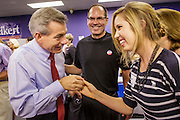 28 AUGUST 2012 - PHOENIX, AZ:  Rep. DAVID SCHWEIKERT (R-AZ), left, greets ALYSSA KNAUER at Schweikert's victory party in Phoenix. Schweikert faced Congressman Ben Quayle in what was the hardest Republican primary election in Arizona in 2012. Both were incumbent Republican freshmen elected to Congress from neighboring districts in 2010. They ended up in the same district at the end of the redistricting process and faced off against each other in the primary to represent Arizona's 6th Congressional District, which is made up of Scottsdale, Paradise Valley and parts of Phoenix. The district is solidly Republican and the winner of the primary is widely expected to win November's general election. Both are conservative Republicans with Tea Party backing.   PHOTO BY JACK KURTZ