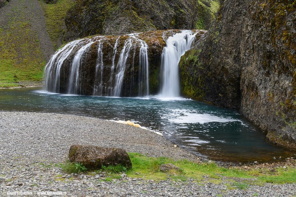 The Stjornarfoss waterfall is near the town Kirkjubaejarklaustur.