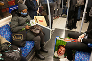 Face of Will Ferrell on an Elf shopping bag amongst commuters on a busy underground train on 4th December 2020 in London, United Kingdom. Elf is a 2003 American Christmas comedy film directed by Jon Favreau and starring Will Ferrell. The film centers on Buddy, a human who was adopted and raised by Santas elves.