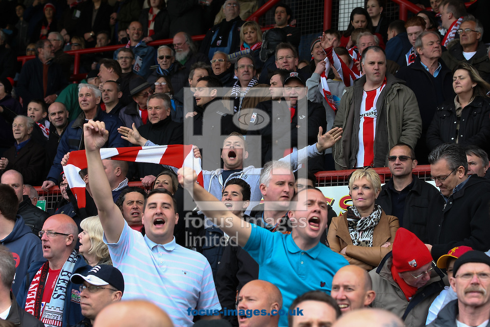 Picture by David Horn/Focus Images Ltd +44 7545 970036.27/04/2013.Brentford fans  during the npower League 1 match at Griffin Park, London.