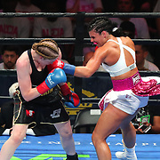 Alicia Napoleon (R) from Brooklyn, New York exchanges blows with Hannah Rankin of Scotland during a Premier Boxing Champions fight on Saturday, August 4, 2018 at the Nassau Veterans Memorial Coliseum in Uniondale, New York.  (Alex Menendez via AP)