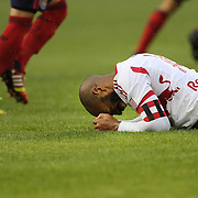 Thierry Henry, New York Red Bulls, feels the pain of a strong tackle during the New York Red Bulls V Chivas USA, Major League Soccer regular season match at Red Bull Arena, Harrison, New Jersey. USA. 30th March 2014. Photo Tim Clayton
