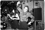 Man dancing at Barbi Benton Party, ( Barbi's husband) Aspen Colorado1995© Copyright Photograph by Dafydd Jones 66 Stockwell Park Rd. London SW9 0DA Tel 020 7733 0108 www.dafjones.com