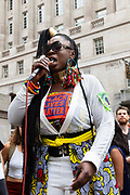 A Black Lives Matter and Extinction Rebellion activist gives an impassioned speach at a climate action protest outside the Bank of England on 27th August, 2021 in London, United Kingdom. The activist group Extinction Rebellion XR are planning actions of disruption for two weeks straight beginning on August 23rd, 2021 in an effort to bring awareness and priority to the global climate emergency in advance of the COP 26 Summit which will be held in Glasgow later this year.