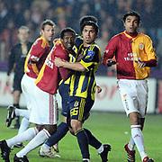Galatasaray's Abdul Kader KEITA (L), Mustafa SARP (R) and Fenerbahce's Mehmet TOPUZ (C) during their Turkish superleague soccer derby match Galatasaray between Fenerbahce at the AliSamiYen Stadium at Mecidiyekoy in Istanbul Turkey on Sunday, 28 March 2010. Photo by TURKPIX