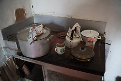 The simple kitchen with coal burning oven, used for cooking as well as to heat 84-year-old Nina Morozova's whole apartment in Debaltsevo.