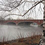 Rainy day on the Charles River. The John W. Weeks Bridge is the only pedestrian-only bridge crossing the Charles River between Cambridge and Boston.