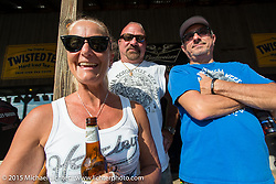 AJ and friends at the Broken Spoke during Laconia Motorcycle Week. Laconia, NH, USA. June 13, 2015.  Photography ©2015 Michael Lichter.