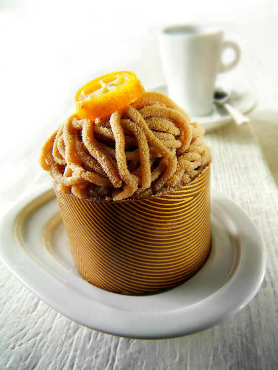 A modern cakes with a pattered choclate cases, filled with chestnut puree and Kirch sponge