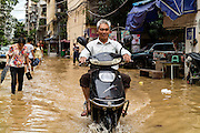 FUZHOU, CHINA - SEPTEMBER 15: <br /> <br /> A man rides a motorcycle in a flooded road after Typhoon Meranti on September 15, 2016 in Fuzhou, Fujian Province of China. Typhoon Meranti made landfall in Xiamen at 3:05 a.m on Thursday and caused damage in Fujian.<br /> ©Exclusivepix Media